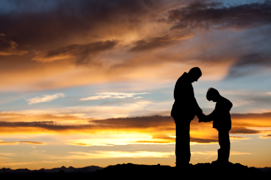 Silhouette of Father and Son Praying