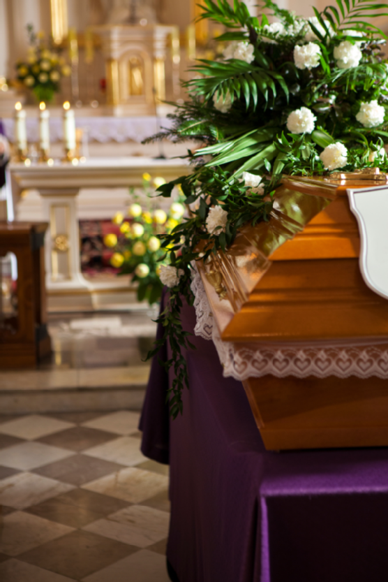 Rest In Peace - simply wooden coffin at church